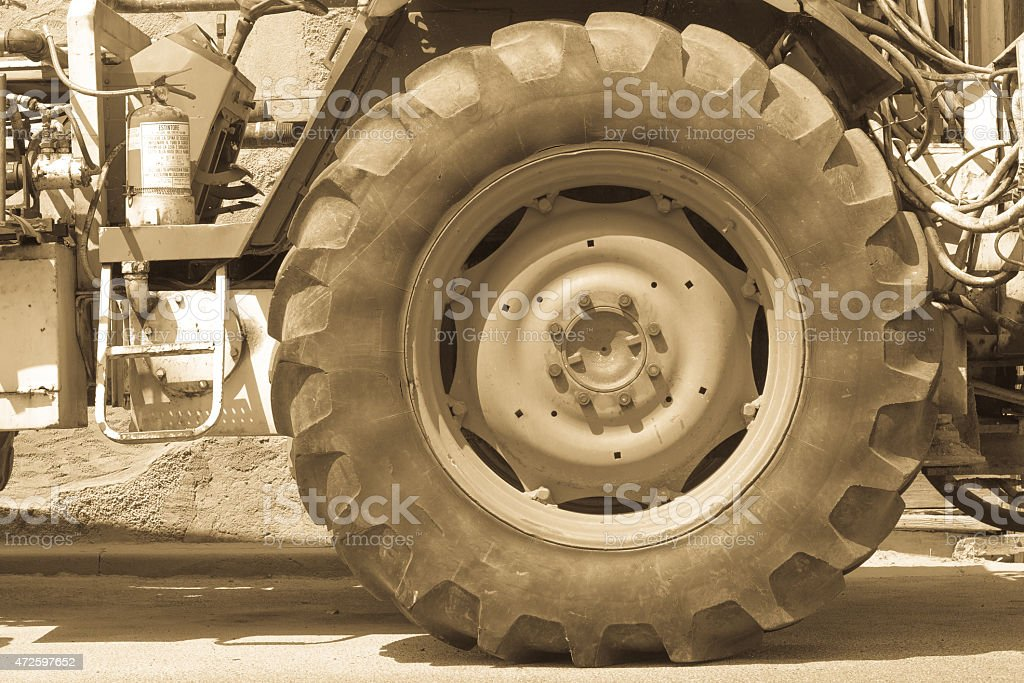 Driving wheel in old tractor stock photo
