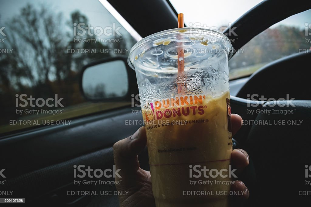 Driving while drinking coffee stock photo