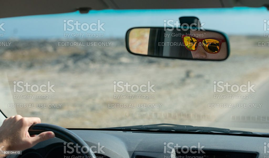 Driving with colorful sunglasses royalty-free stock photo