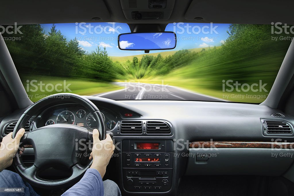 Driving with driver behind the steering wheel - speed concept stock photo