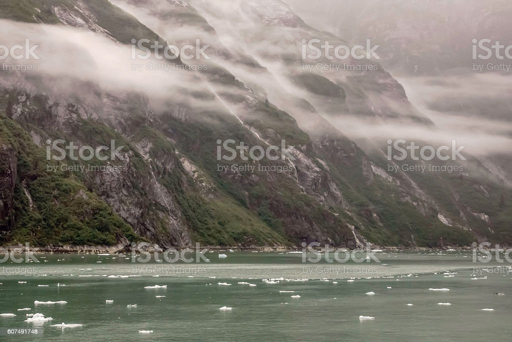 Drizzly waterway with mountains stock photo