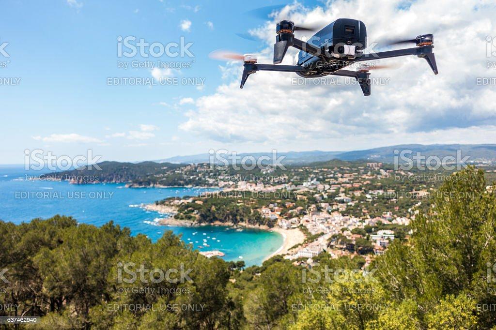 dron drone coast beach summer clouds sun horizontal bebop parrot stock photo
