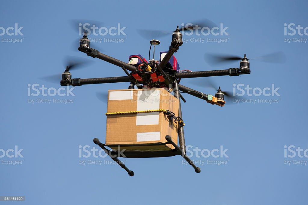 Drone carrying parcel stock photo