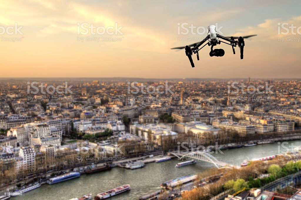 Drone flying above Paris city panorama stock photo