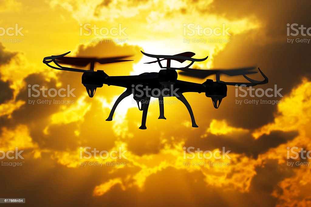 Drone flying in sunset landscape stock photo
