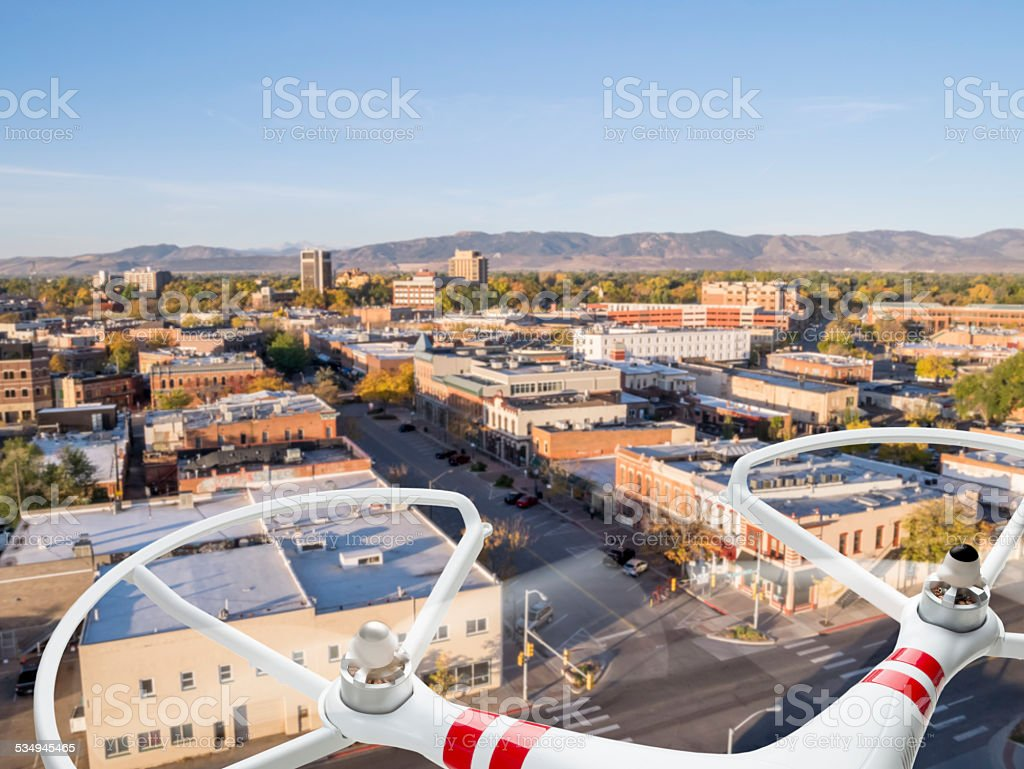 drone flying over city stock photo