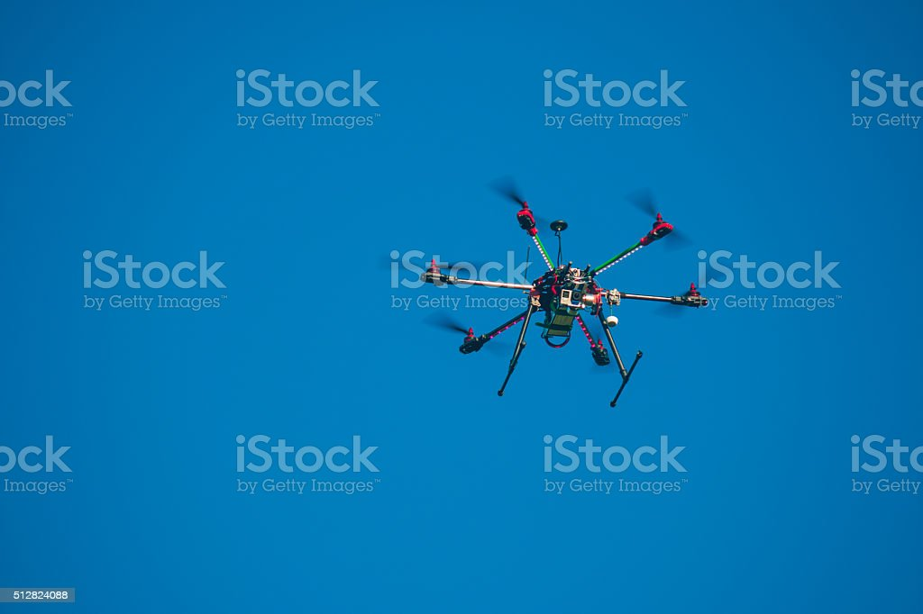 Drone flying over the blue sky stock photo