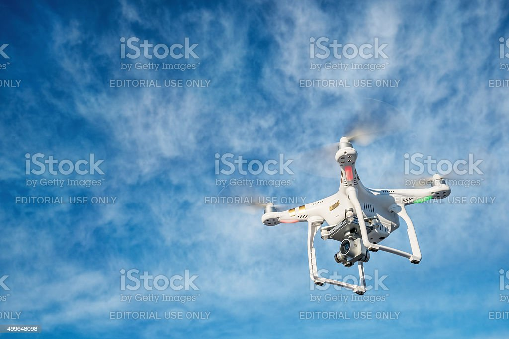 Drone flying with 4K video camera stock photo