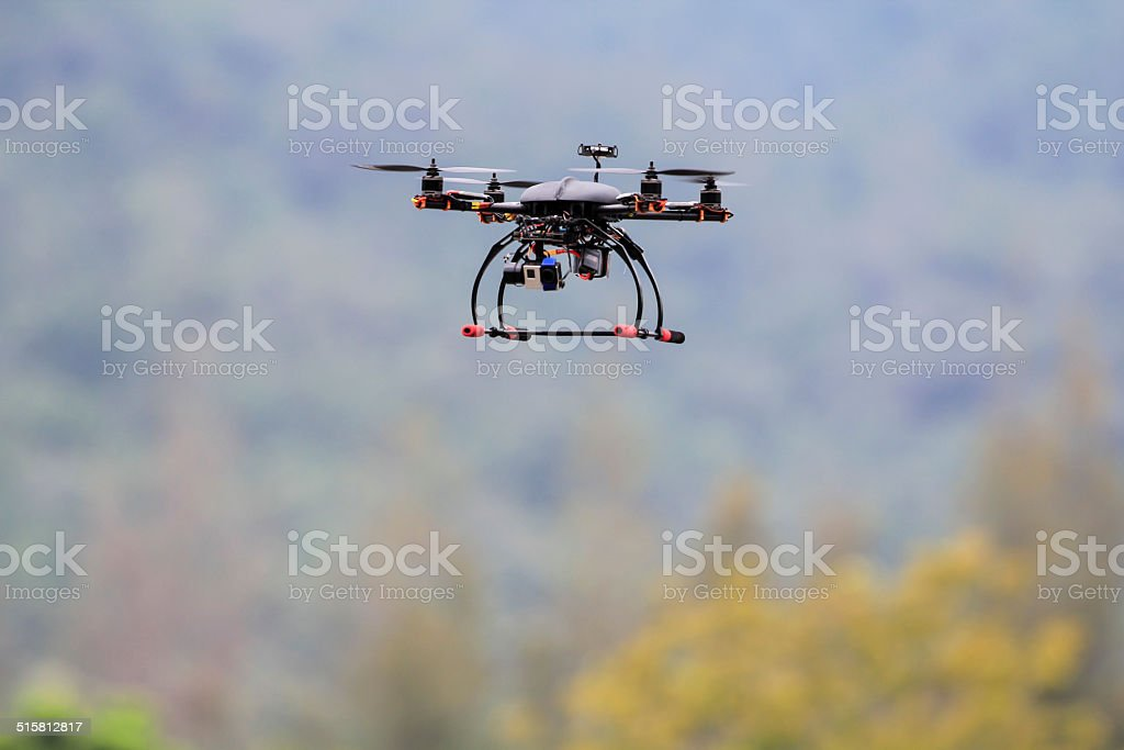 Drone flying with video camera stock photo