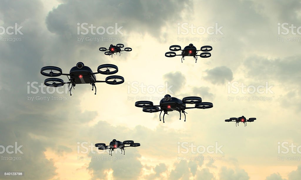 Drone invasion: black flying objects crowd the sky stock photo