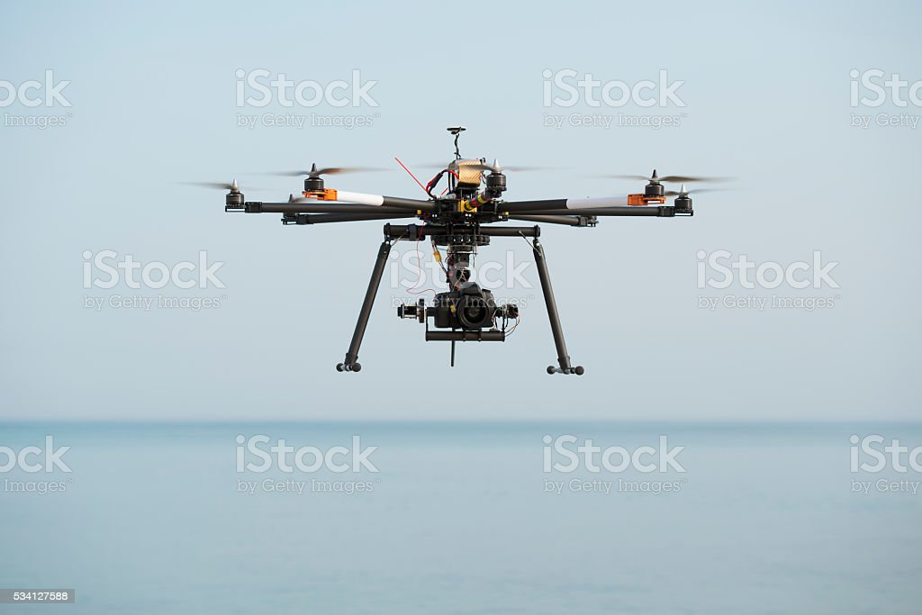 Drone octocopter with DSLR camera flight. stock photo