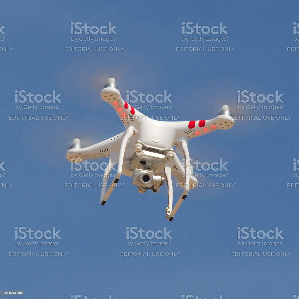 Drone (Unmanned Aerial Vehicle) on the sky searching. stock photo