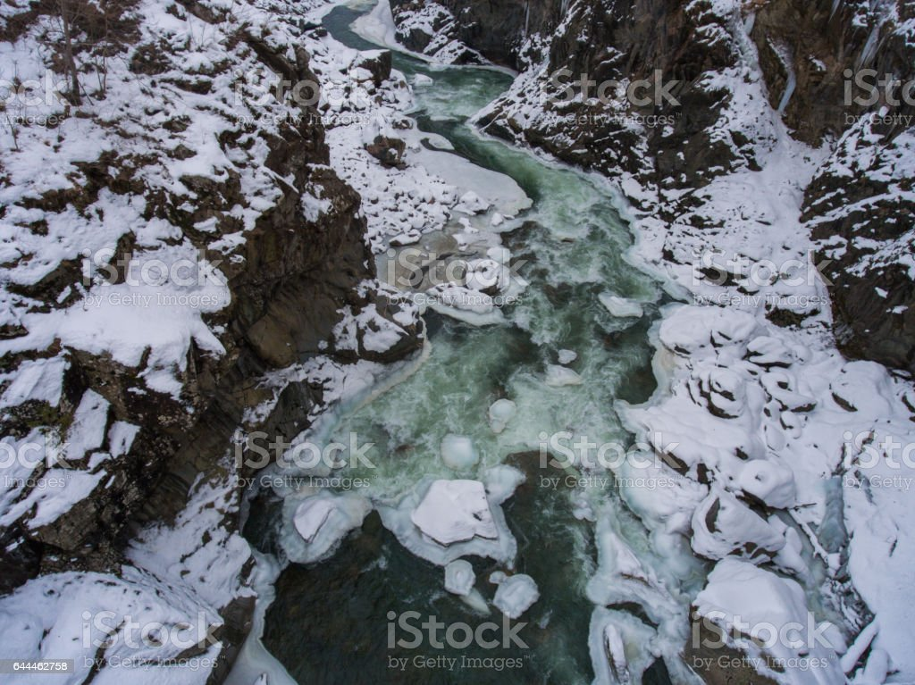 Drone photo. Winter landscape. River flowing in granite canyon stock photo