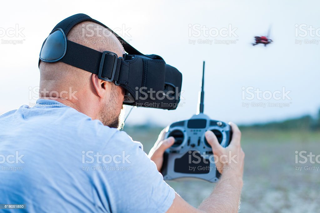 drone pilot using fpv goggles to fly stock photo