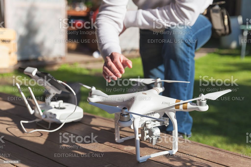 Drone quadrocopter Phantom 3 and pilot stock photo