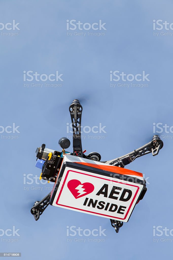 Drone quadrocopter  transporting box with AED stock photo