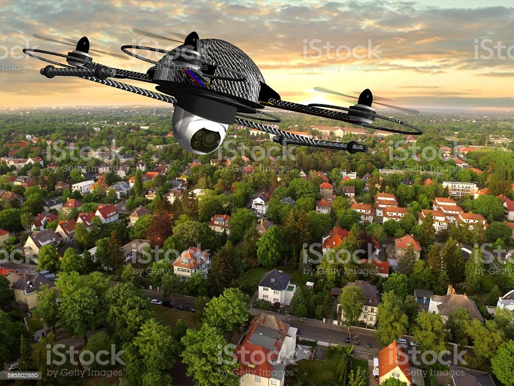 drone quadrocopter with camera in flight over over suburban Houses stock photo
