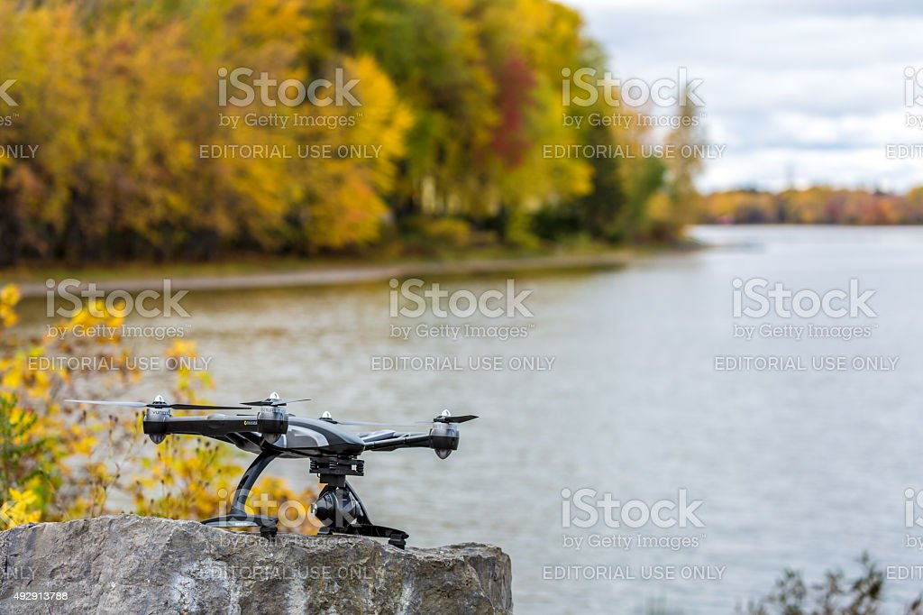 Drone Ready to Fly Over a River during Fall stock photo