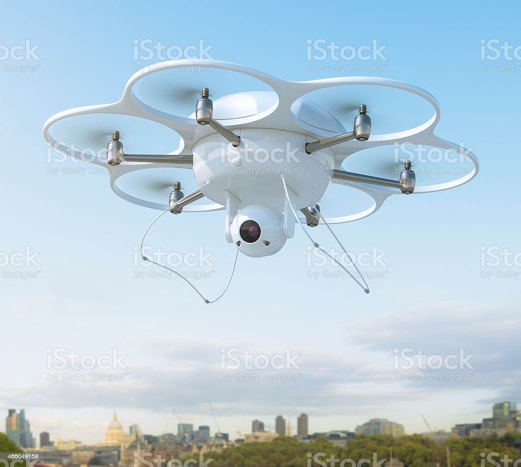 Drone with camera over city stock photo