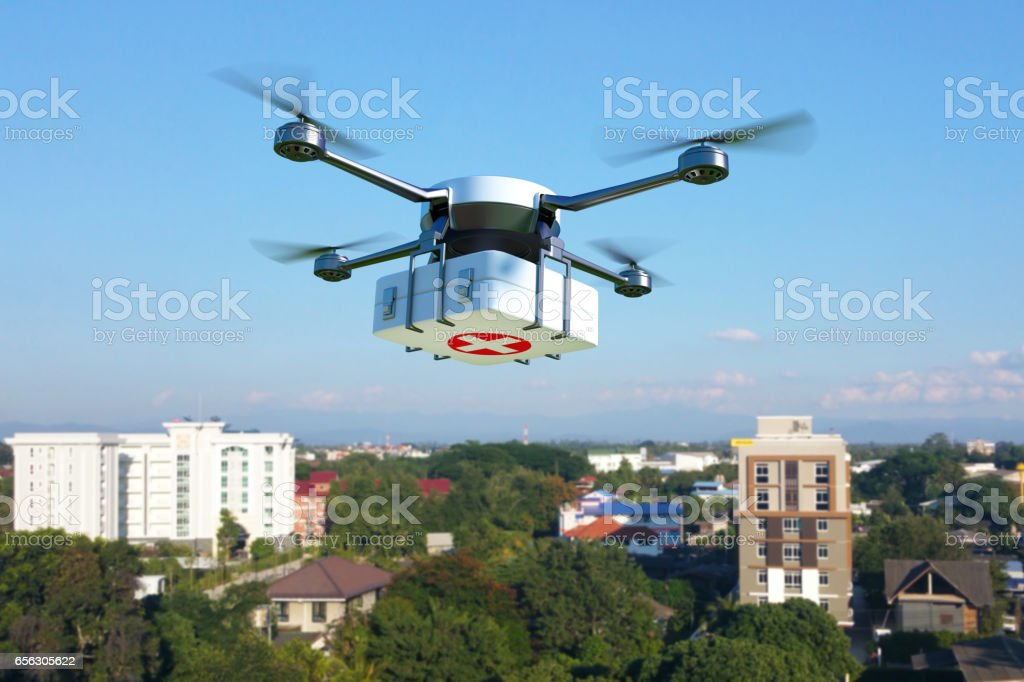 Drone with first aid kit flying over the town. stock photo