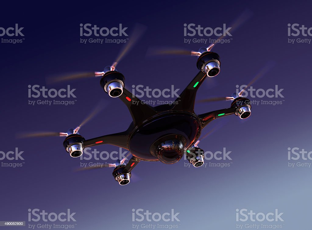 Drone with surveillance camera flying in night sky. stock photo