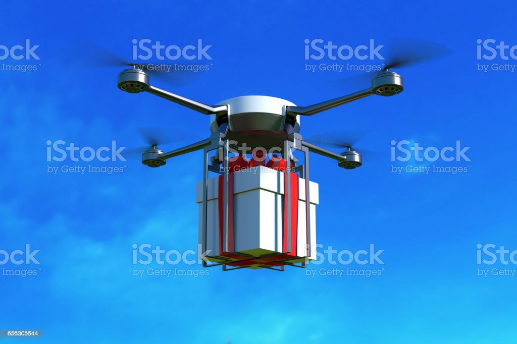 Drone with white gift box on blue sky. stock photo
