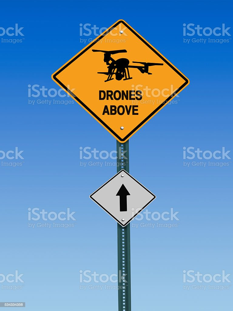 drones above sign stock photo