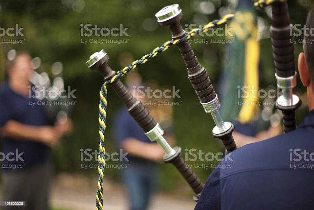 Drones From Back of Bagpiper stock photo