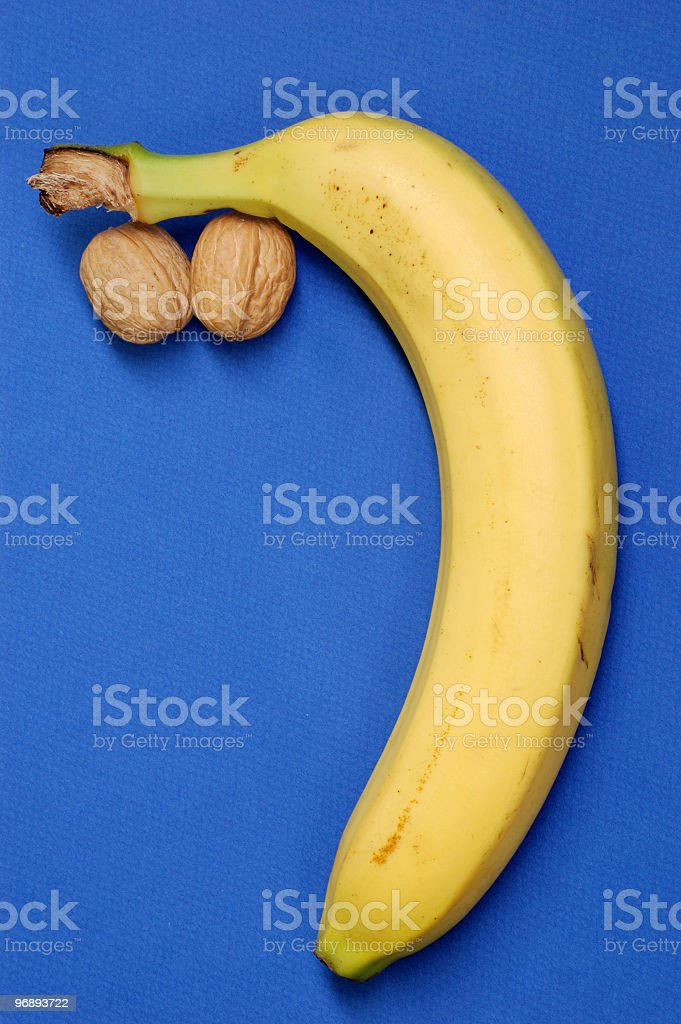 Droopy Banana with Nuts royalty-free stock photo