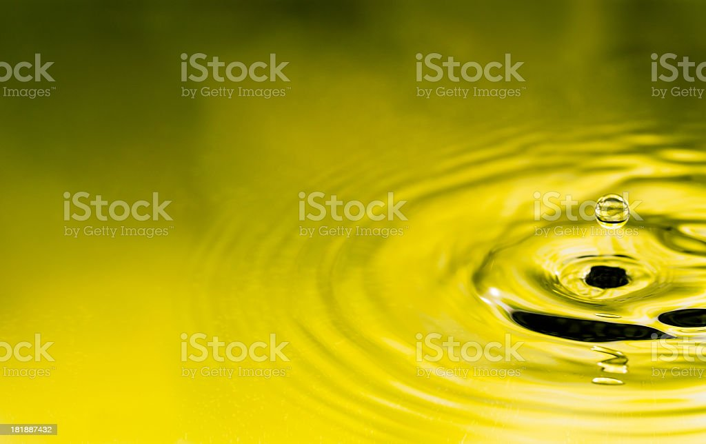 Drop in mid air about to hit water royalty-free stock photo