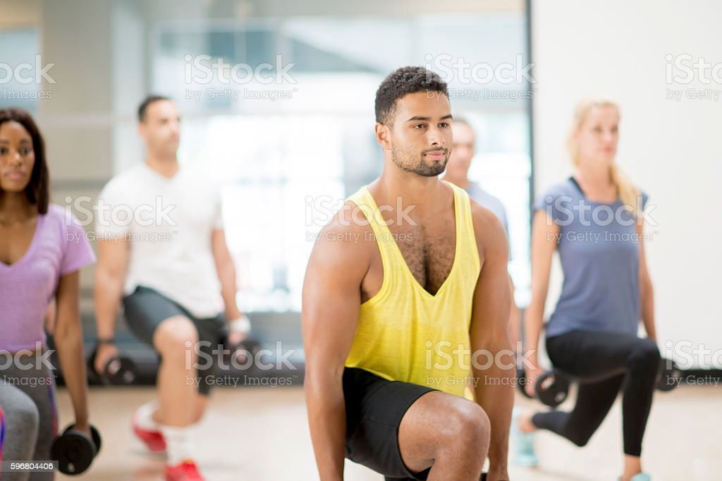 Drop Lunges in a Fitness Class stock photo