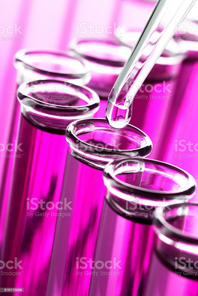 Drop of Liquid in a test Tube stock photo