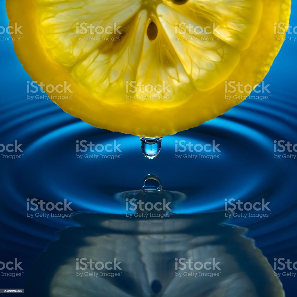 drop of water and lemon stock photo