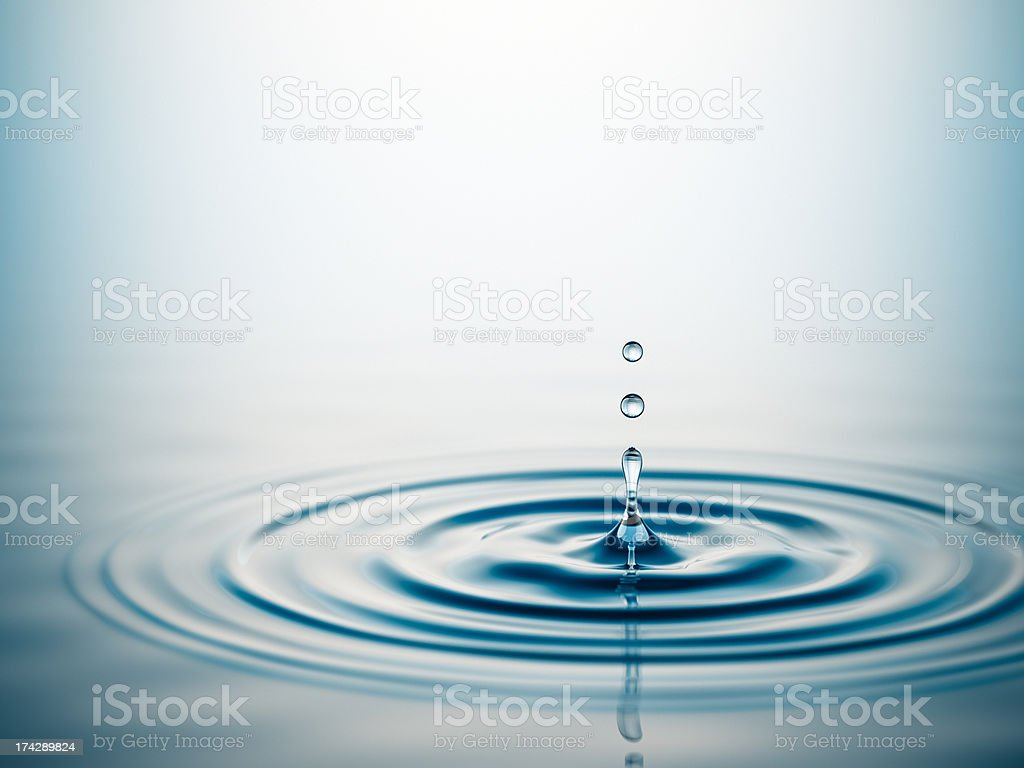 Drop of water in large pool of water  stock photo