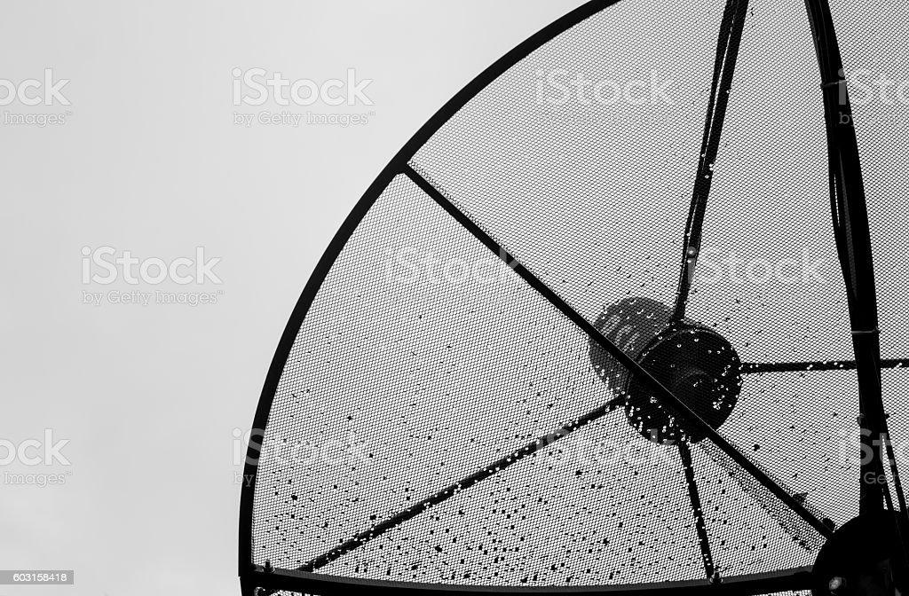 Drop of water on sattellite dish stock photo
