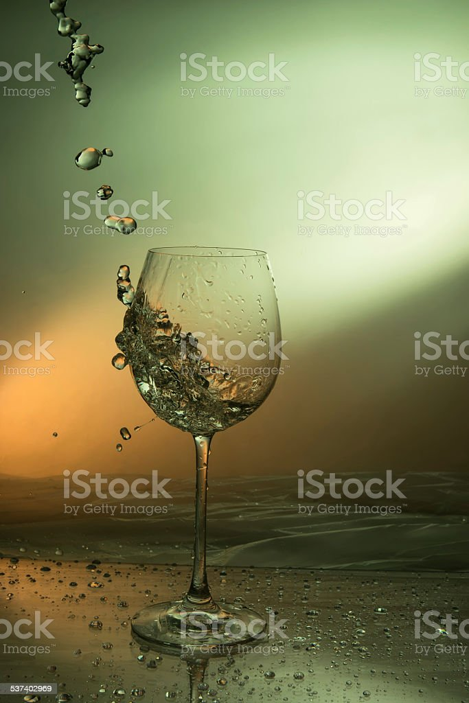 drop splash out of a wine glass stock photo