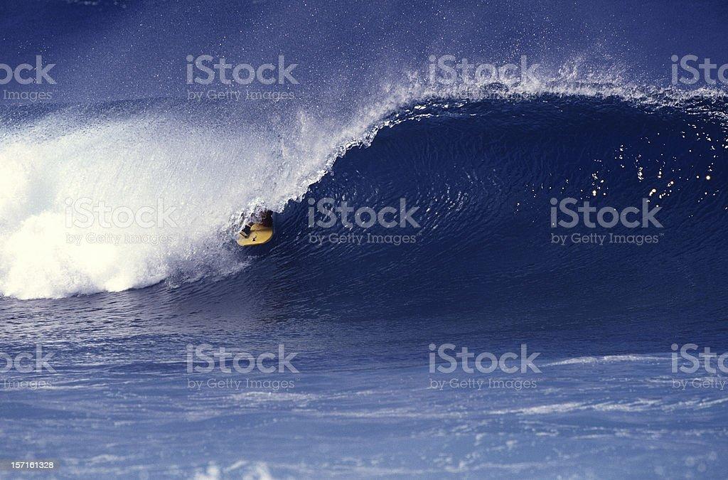 dropknee bodyboarder in a barrelling wave stock photo