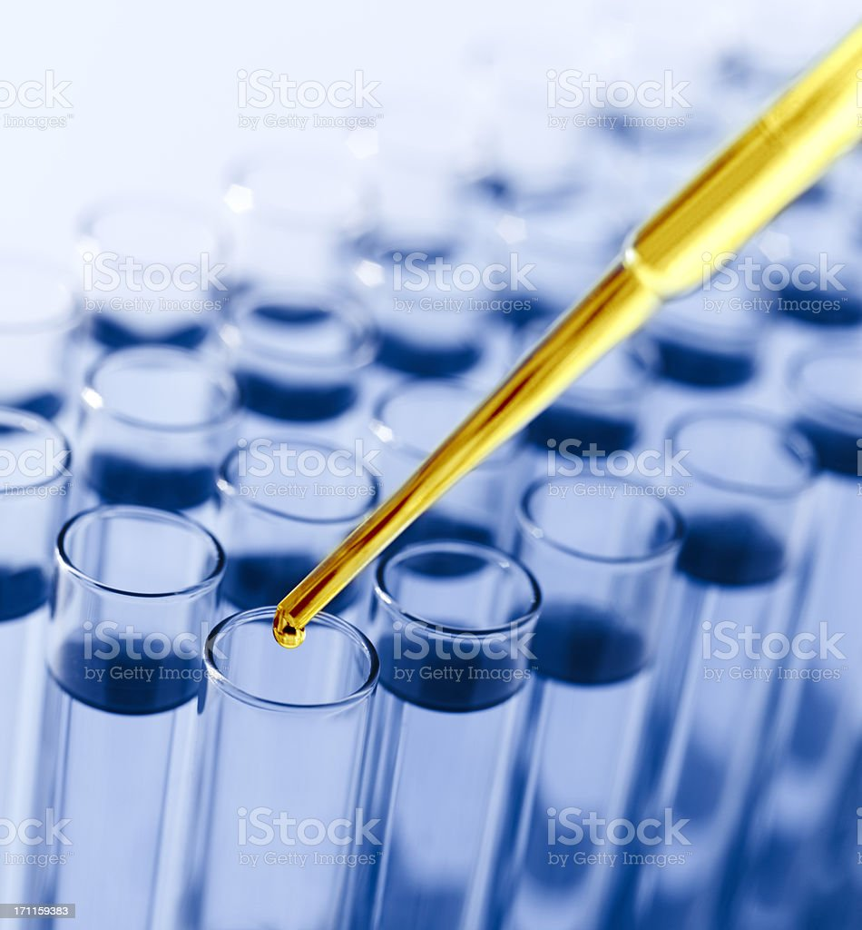 Droplet Falling from Pipette into Test Tube royalty-free stock photo