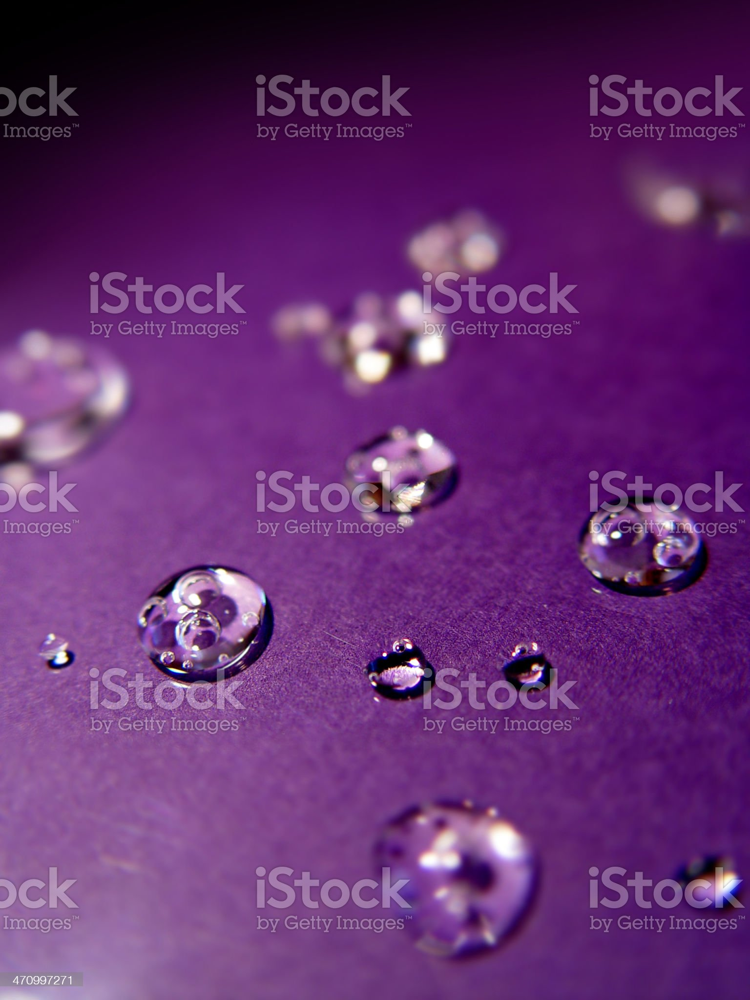 droplets on purple royalty-free stock photo