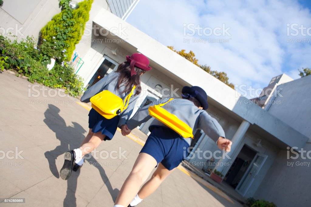 Drop-off to kindergarten children male and female rear view stock photo