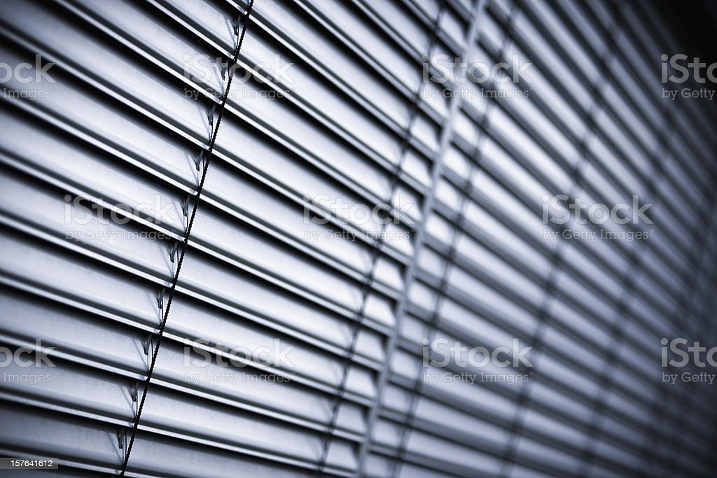 Dropped blinds on windows royalty-free stock photo