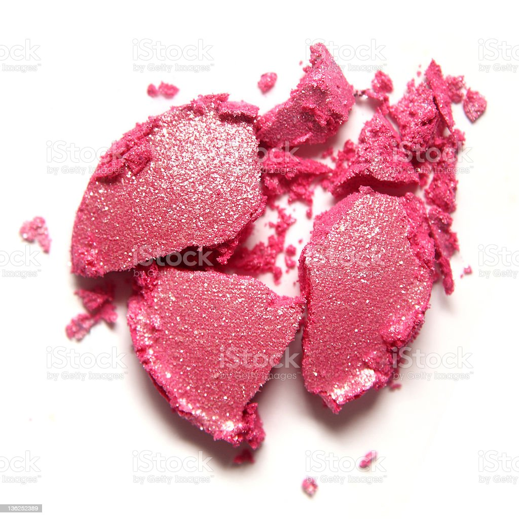 A dropped pink eye shadow that is smashed royalty-free stock photo