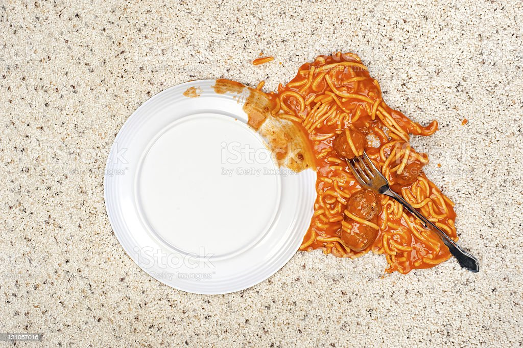 Dropped plate of spaghetti on carpet stock photo