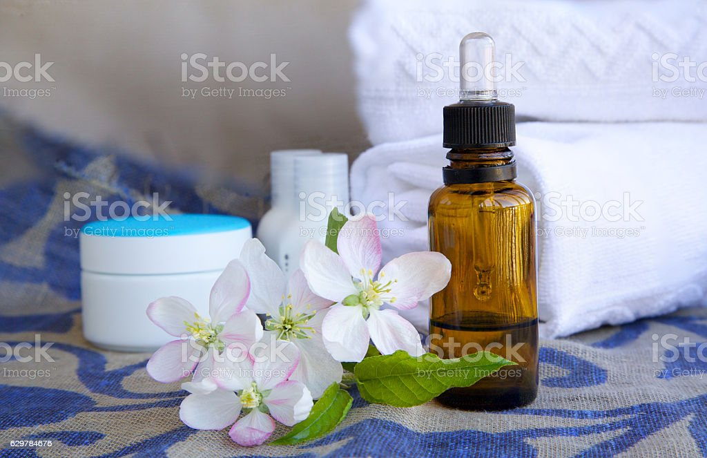 Dropper bottle of apple blossoms extract stock photo
