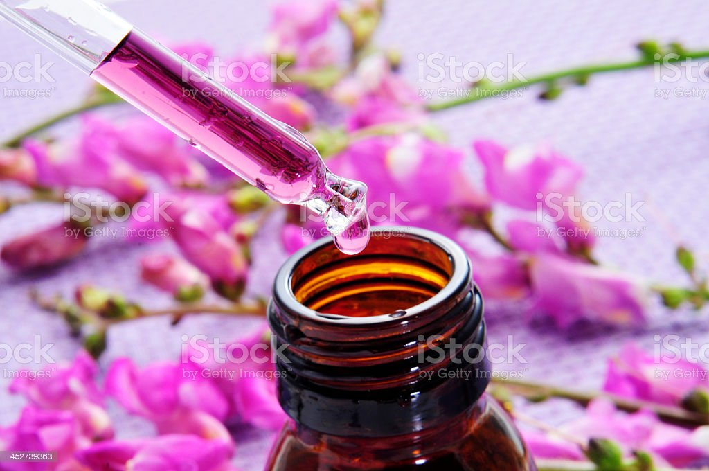 A dropper full of lavender scent stock photo
