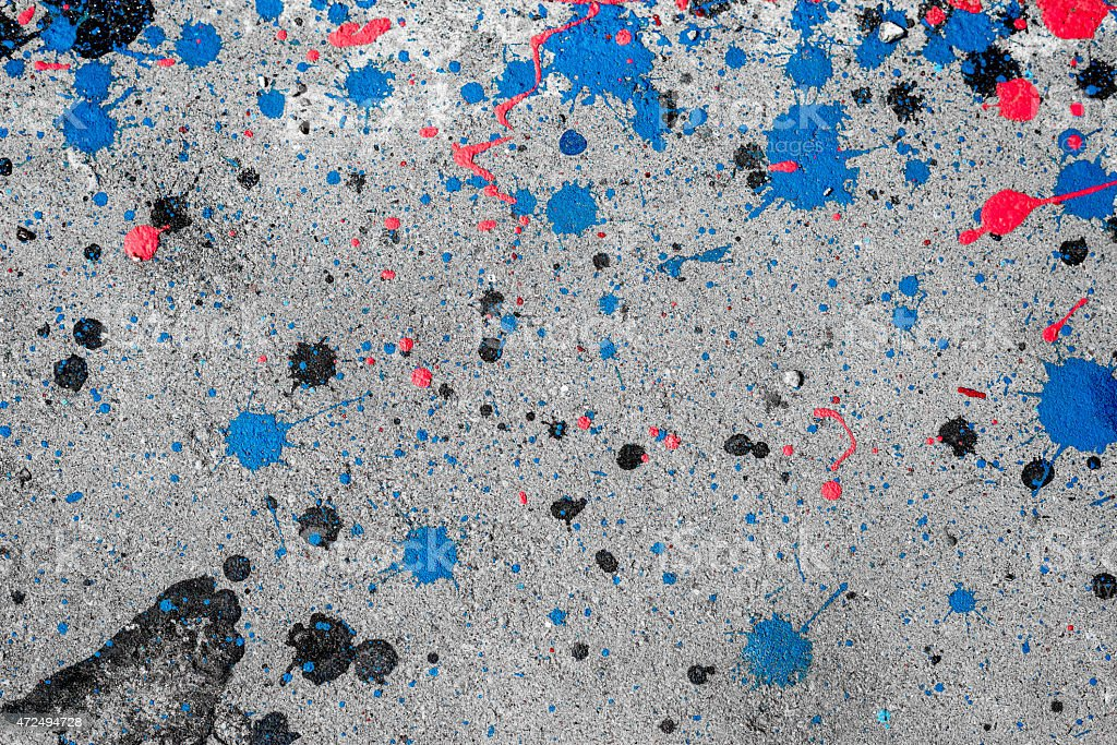 Dropping acrylic paint on the concrete wall. stock photo