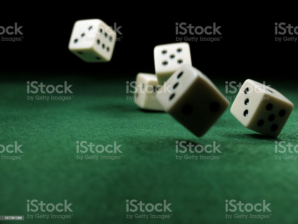 Dropping Dice onto Felt Green Table stock photo