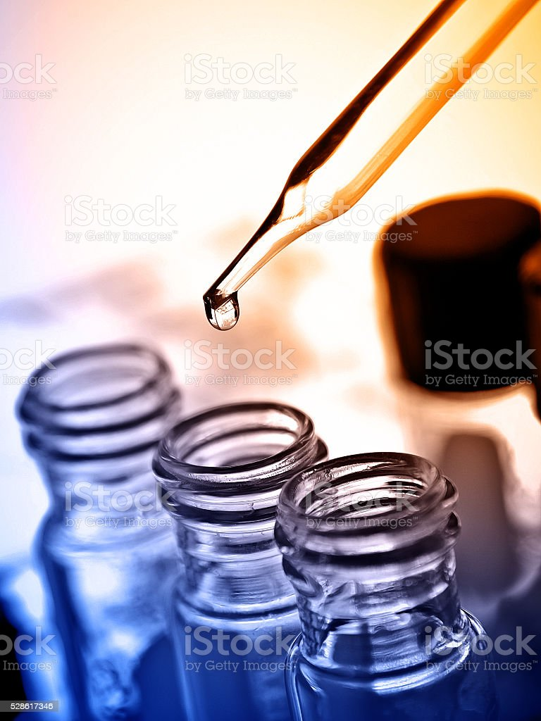 dropping liquid to test tube stock photo