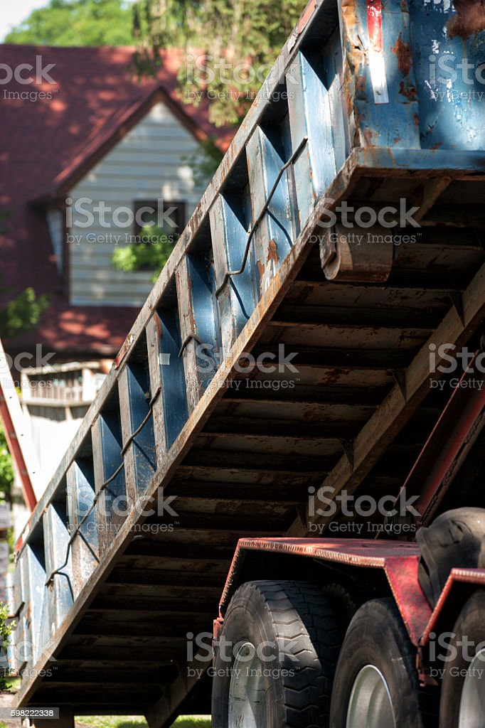 Dropping off a dumpster stock photo