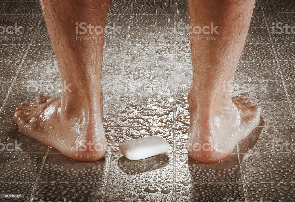 Dropping the soap stock photo